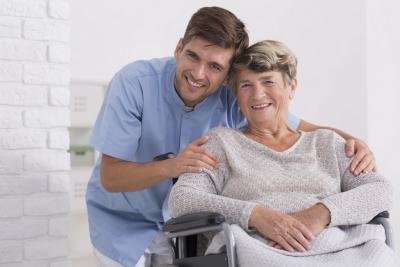 caregiver hugging senior woman with dimentia