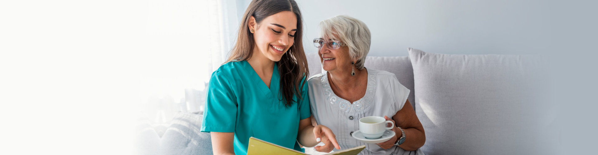 careviger reading to her senior patient